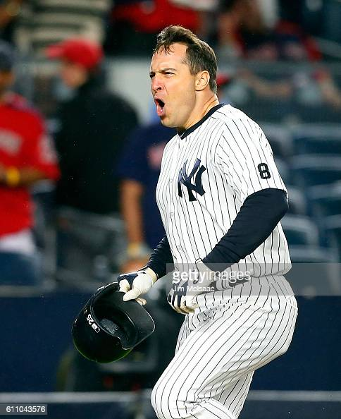 Mark Teixeira of the New York Yankees celebrates his game winning ninth inning grand slam home run against the Boston Red Sox at Yankee Stadium on...