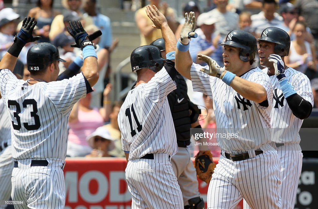 Mark Teixeira #25 (2-R) of the New York Yankees celebrates his third inning grand slam against the New York Mets with teammates Nick Swisher #33, Brett Gardner #11, and Derek Jeter #2 on June 20, 2010 at Yankee Stadium in the Bronx borough of New York City.