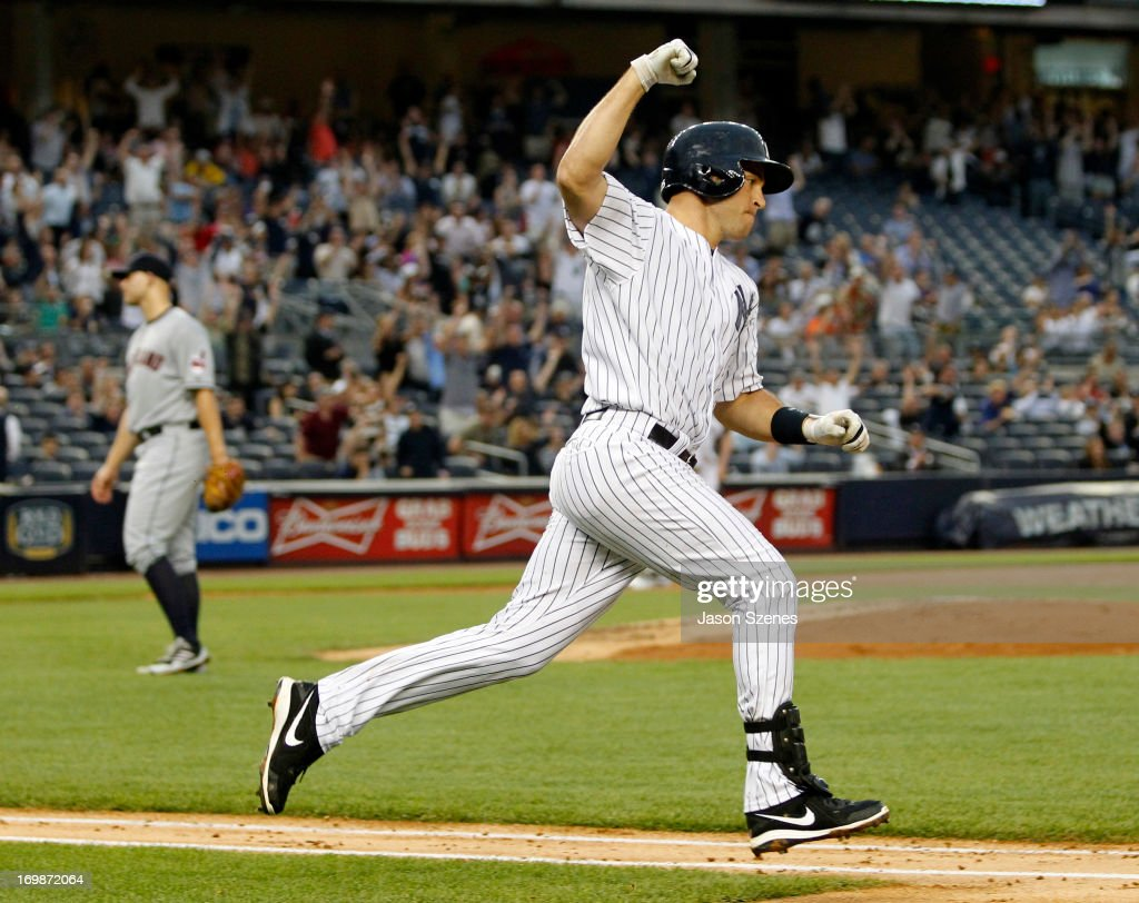 Mark Teixeira of the New York Yankees celebrates his third inning grand slam off of Justin Masterson of the Cleveland Indians in the third inning at...