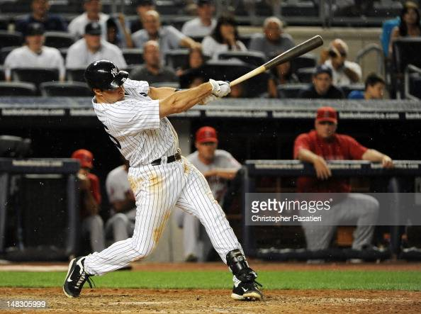 Mark Teixeira of the New York Yankees connects for a game tying threerun homerun in the bottom of the eighth inning against the Los Angeles Angels of...
