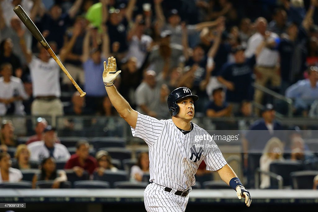 Mark Teixeira #25 of the New York Yankees connects on a game tying 3-run home run in the eighth inning against the Tampa Bay Rays at Yankee Stadium on July 3, 2015 in the Bronx borough of New York City.
