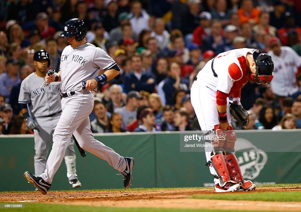 Mark Teixeira #25 of the New York Yankees crosses home plate to score against the Boston Red Sox during the game at Fenway Park on April 22, 2014 in Boston, Massachusetts.