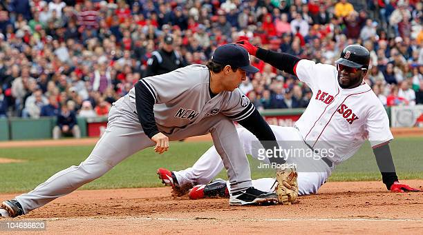 Mark Teixeira of the New York Yankees executes the second out of a double play on base runner David Ortiz of the Boston Red Sox who was caught off of...