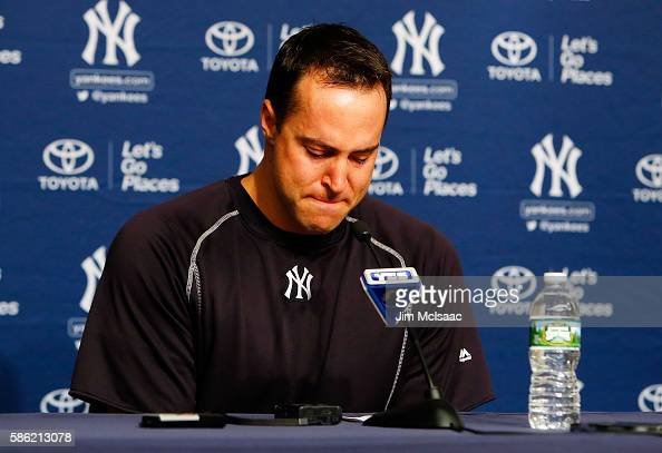 Mark Teixeira of the New York Yankees fights back tears as he announces his retirement at the end of the season during a press conference prior to...