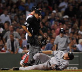 Mark Teixeira of the New York Yankees gets hit by a pitch in the sixth inning against the Boston Red Sox at Fenway Park on September 1 2011 in Boston...