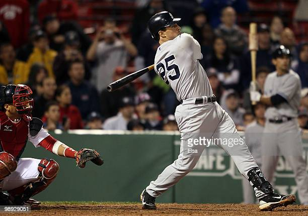 Mark Teixeira of the New York Yankees hit a two run homer in the ninth inning as Victor Martinez of the Boston Red Sox defends on May 8 2010 at...