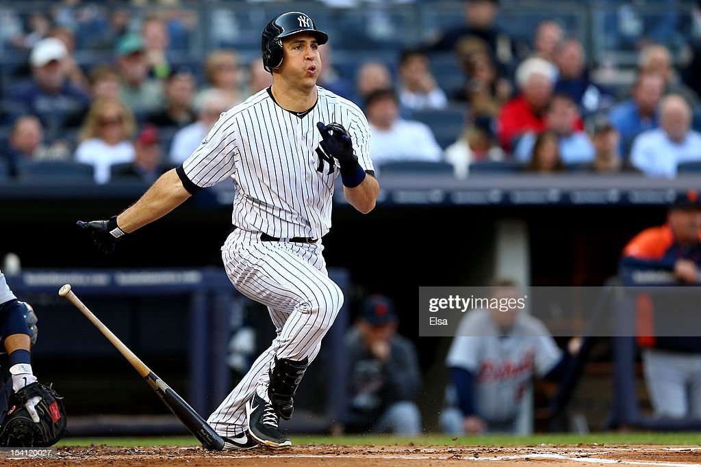 Mark Teixeira #25 of the New York Yankees hits a double in the bottom of the first inning against the Detroit Tigers during Game Two of the American League Championship Series at Yankee Stadium on October 14, 2012 in the Bronx borough of New York City.