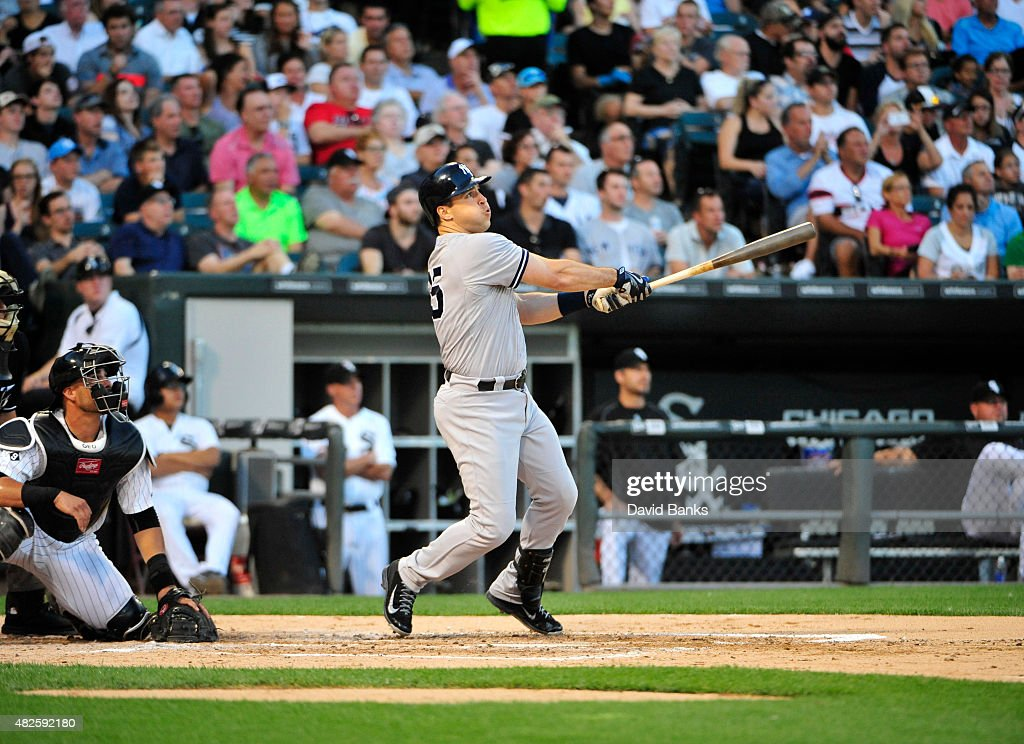 <a gi-track='captionPersonalityLinkClicked' href=/galleries/search?phrase=Mark+Teixeira&family=editorial&specificpeople=209239 ng-click='$event.stopPropagation()'>Mark Teixeira</a> #25 of the New York Yankees hits a grand slam home run against the Chicago White Sox during the second inning on July 31, 2015 at U.S. Cellular Field in Chicago, Illinois.
