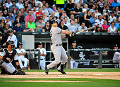 Mark Teixeira of the New York Yankees hits a grand slam home run against the Chicago White Sox during the second inning on July 31 2015 at US...