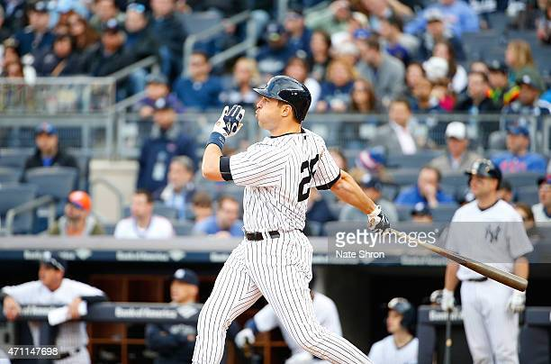 Mark Teixeira of the New York Yankees hits a home run in the eighth inning against the New York Mets on April 25 2015 at Yankee Stadium in the Bronx...