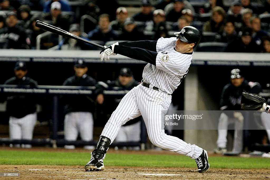 Mark Teixeira of the New York Yankees hits a single in the third inning against of the Los Angeles Angels of Anaheim in Game One of the ALCS during...