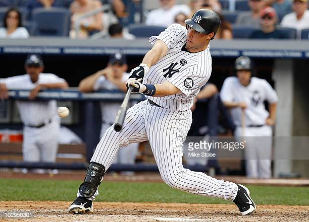 Mark Teixeira of the New York Yankees hits a solo home run in the fifthinning against the Tampa Bay Rays on July 17 2010 at Yankee Stadium in the...