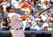 Mark Teixeira of the New York Yankees hits a solo home run in the third inning against the Milwaukee Brewers during their game on June 30 2011 at...