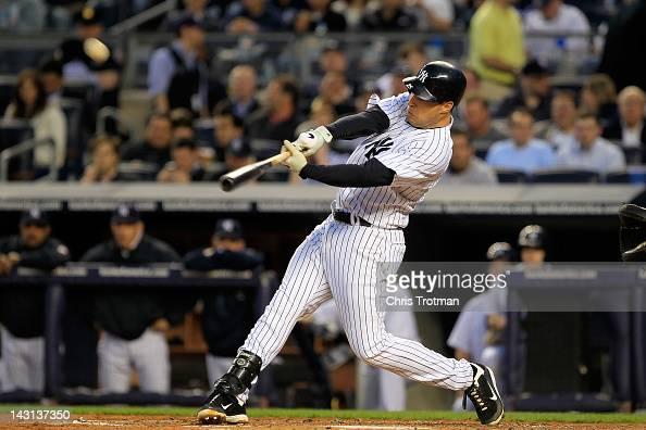 Mark Teixeira of the New York Yankees hits a two run homer in the first inning against the Minnesota Twins on April 19 2012 at Yankee Stadium in the...