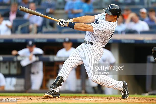 Mark Teixeira of the New York Yankees hits a tworun home run in the first inning against the Baltimore Orioles at Yankee Stadium on July 22 2015 in...