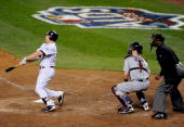 Mark Teixeira of the New York Yankees hits a walk off home run in the eleventh inning against the Minnesota Twins in Game Two of the ALDS during the...