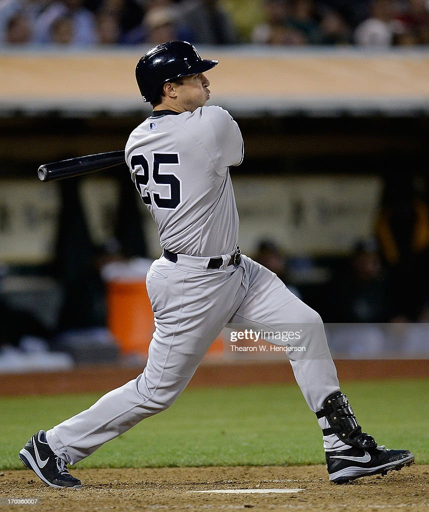 <a gi-track='captionPersonalityLinkClicked' href=/galleries/search?phrase=Mark+Teixeira&family=editorial&specificpeople=209239 ng-click='$event.stopPropagation()'>Mark Teixeira</a> #25 of the New York Yankees hits an RBI single driving in Brett Gardner #11 in the eighth inning against the Oakland Athletics at O.co Coliseum on June 11, 2013 in Oakland, California.