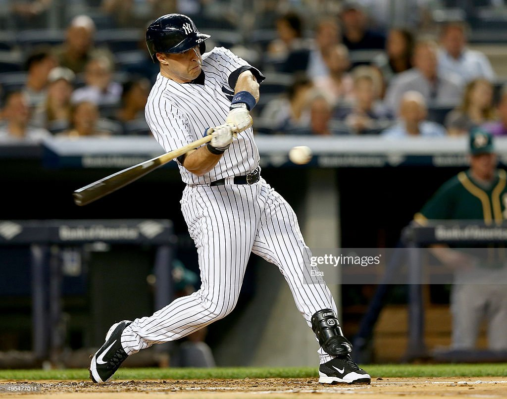Mark Teixeira #25 of the New York Yankees hits an RBI single in the first inning against the Oakland Athletics on June 3, 2014 at Yankee Stadium in the Bronx borough of New York City.