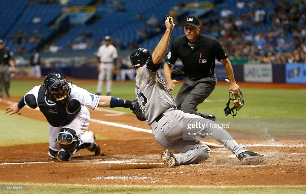 Mark Teixeira #25 of the New York Yankees is tagged out at home by catcher Bobby Wilson #46 of the Tampa Bay Rays to end the top of the fifth inning of a game as he attempts to score on the throw off of a single by Carlos Beltran #36 on May 13, 2015 at Tropicana Field in St. Petersburg, Florida.