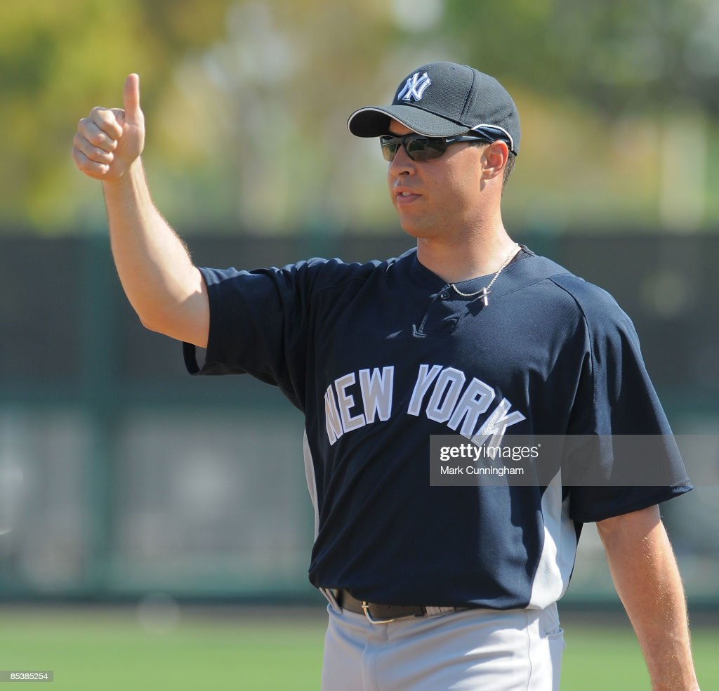 Mark Teixeira of the New York Yankees looks on against the Detroit Tigers during the spring training game at Joker Marchant Stadium on March 11 2009...