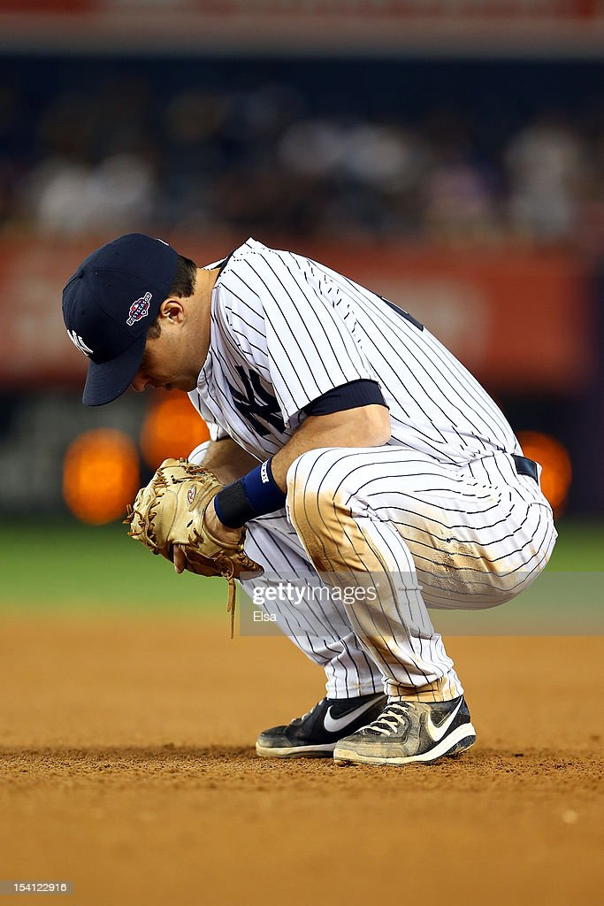 Mark Teixeira #25 of the New York Yankees looks on dejected against the Detroit Tigers during Game Two of the American League Championship Series at Yankee Stadium on October 14, 2012 in the Bronx borough of New York City.