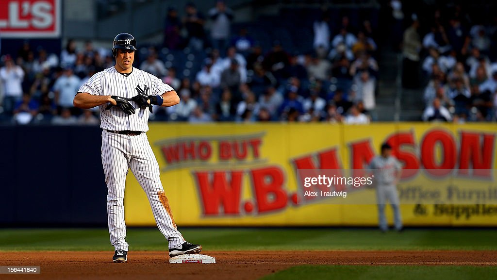 Mark Teixeira #25 of the New York Yankees looks on from second base against the Detroit Tigers during Game Two of the American League Championship Series at Yankee Stadium on October 14, 2012 in the Bronx borough of New York City.