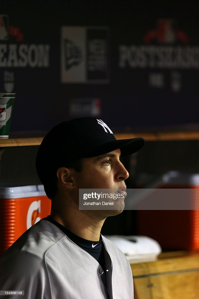 Mark Teixeira #25 of the New York Yankees looks on from the dugout against the Detroit Tigers during game four of the American League Championship Series at Comerica Park on October 18, 2012 in Detroit, Michigan.