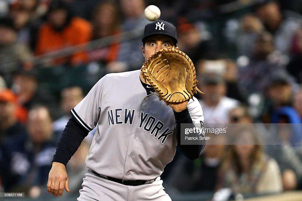 <a gi-track='captionPersonalityLinkClicked' href=/galleries/search?phrase=Mark+Teixeira&family=editorial&specificpeople=209239 ng-click='$event.stopPropagation()'>Mark Teixeira</a> #25 of the New York Yankees makes an out at first base on Jonathan Schoop #6 of the Baltimore Orioles (not pictured) in the second inning at Oriole Park at Camden Yards on May 5, 2016 in Baltimore, Maryland.