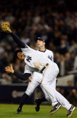 Mark Teixeira of the New York Yankees miscommunicates with David Robertson and misses a catch in the top of the twelfth inning during Game Three of...