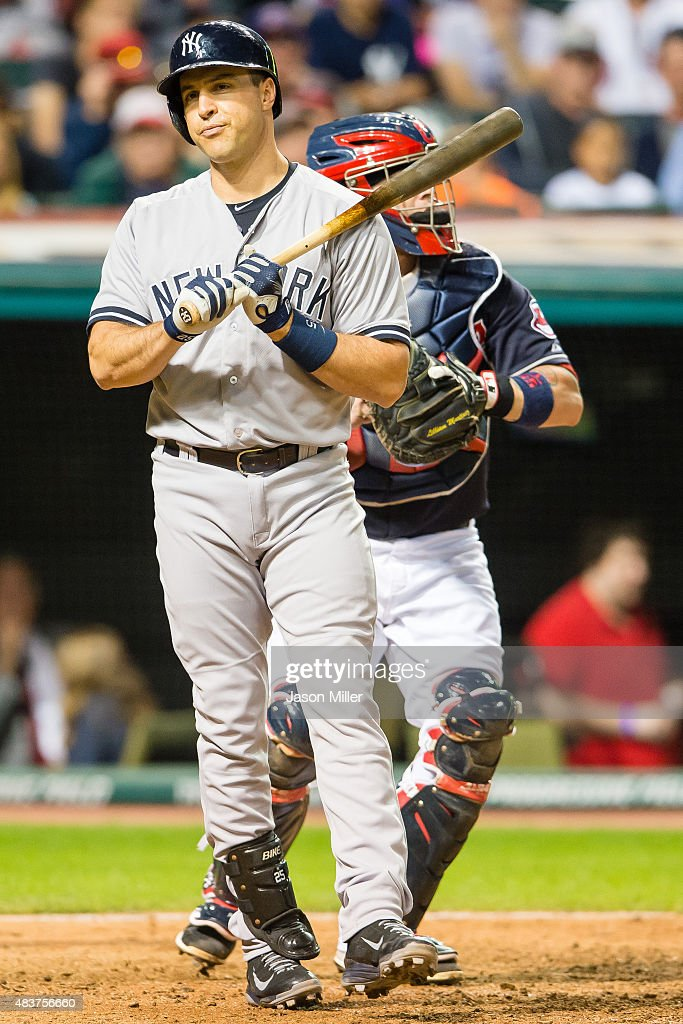 Mark Teixeira #25 of the New York Yankees reacts after striking out during the ninth inning against the Cleveland Indians at Progressive Field on August 12, 2015 in Cleveland, Ohio. The Indians defeated the Yankees 2-1.