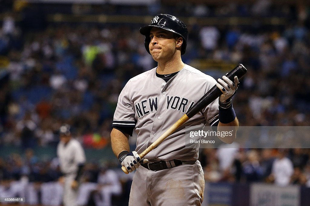 Mark Teixeira of the New York Yankees reacts after striking out looking with the bases loaded to end the top of the eighth inning of a game against...