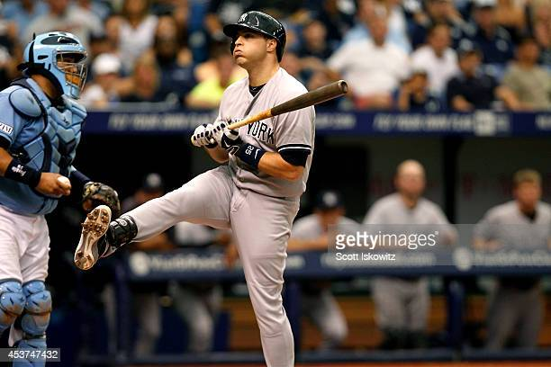 Mark Teixeira of the New York Yankees reacts from a close pitch during the fifth inning against the Tampa Bay Rays at Tropicana Field on August 17...