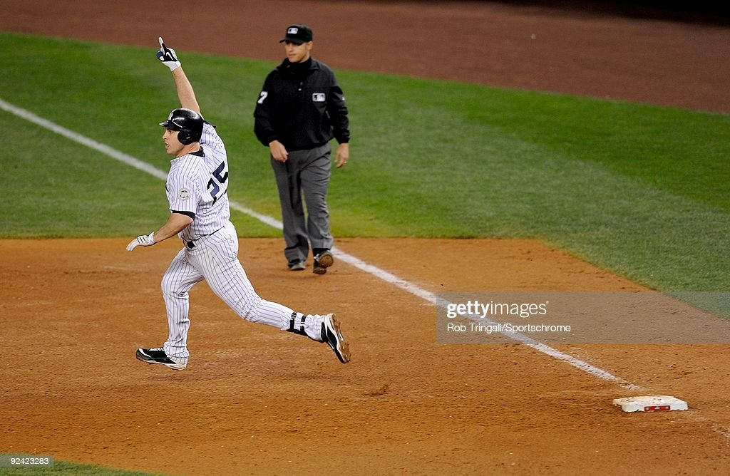 <a gi-track='captionPersonalityLinkClicked' href=/galleries/search?phrase=Mark+Teixeira&family=editorial&specificpeople=209239 ng-click='$event.stopPropagation()'>Mark Teixeira</a> #25 of the New York Yankees reacts rounding first base after hitting a walk off home run in the eleventh inning against the Minnesota Twins in Game Two of the ALDS during the 2009 MLB Playoffs at Yankee Stadium on October 9, 2009 in the Bronx borough of New York City.The Yankees defeated the Twins 4-3.