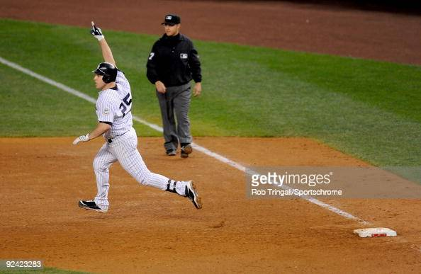 Mark Teixeira of the New York Yankees reacts rounding first base after hitting a walk off home run in the eleventh inning against the Minnesota Twins...