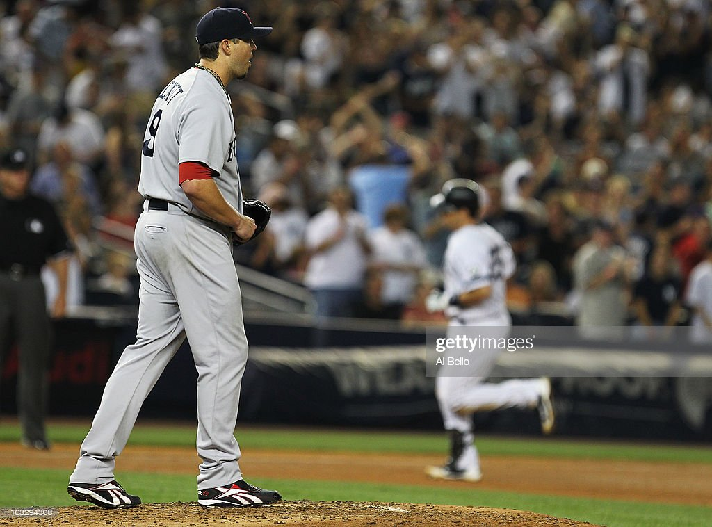 <a gi-track='captionPersonalityLinkClicked' href=/galleries/search?phrase=Mark+Teixeira&family=editorial&specificpeople=209239 ng-click='$event.stopPropagation()'>Mark Teixeira</a> #25 of the New York Yankees rounds the bases after hitting a home run against <a gi-track='captionPersonalityLinkClicked' href=/galleries/search?phrase=Josh+Beckett&family=editorial&specificpeople=206314 ng-click='$event.stopPropagation()'>Josh Beckett</a> #19 the Boston Red Sox during their game on August 8, 2010 at Yankee Stadium in the Bronx borough of New York City.