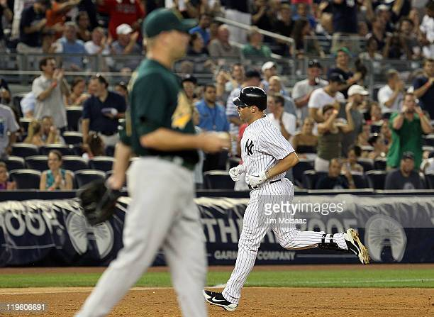 Mark Teixeira of the New York Yankees runs the bases after his third inning grand slam against Michael Wuertz of the Oakland Athletics on July 22...