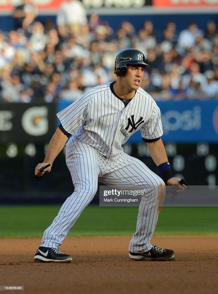 Mark Teixeira #25 of the New York Yankees runs the bases against the Detroit Tigers during Game Two of the American League Championship Series at Yankee Stadium on October 14, 2012 in the Bronx borough of New York City, New York. The Tigers defeated the Yankees 3-0.
