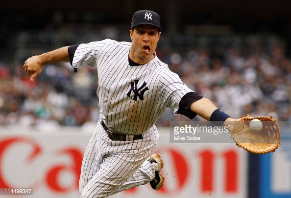 Mark Teixeira of the New York Yankees shuffles the ball to Ivan Nova for an out against the New York Mets on May 22 2011 at Yankee Stadium in the...
