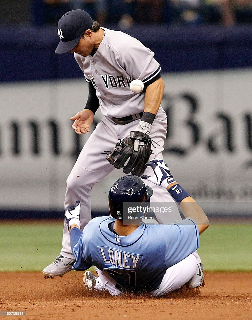 Mark Teixeira #25 of the New York Yankees singles to right field in front of catcher Ryan Hanigan #24 of the Tampa Bay Rays during the sixth inning of a game on April 20, 2014 at Tropicana Field in St. Petersburg, Florida.