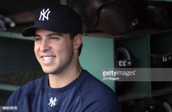 Mark Teixeira of the New York Yankees smiles while talking to reporters before a game against the Boston Red Sox at Fenway Park on May 9 2010 in...