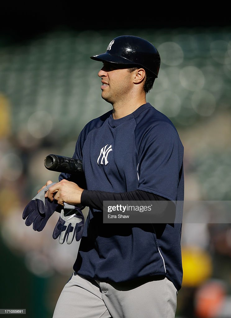 <a gi-track='captionPersonalityLinkClicked' href=/galleries/search?phrase=Mark+Teixeira&family=editorial&specificpeople=209239 ng-click='$event.stopPropagation()'>Mark Teixeira</a> #25 of the New York Yankees stands on the field during batting practice before their game against the Oakland Athletics at O.co Coliseum on June 12, 2013 in Oakland, California.