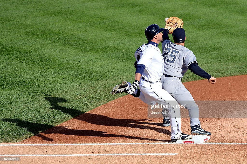 Mark Teixeira #25 of the New York Yankees stretches for the ball as Omar Infante #4 of the Detroit Tigers beats the throw to reach first safely on an infield single in the first inning during game four of the American League Championship Series at Comerica Park on October 18, 2012 in Detroit, Michigan.
