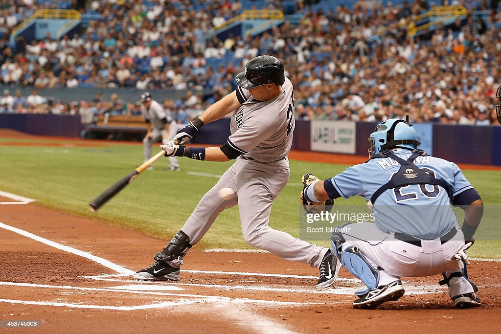 Mark Teixeira #25 of the New York Yankees swings at the ball during the first inning against the Tampa Bay Rays at Tropicana Field on August 17, 2014 in St Petersburg, Florida.