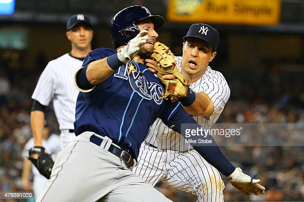 Mark Teixeira of the New York Yankees tags out Kevin Kiermaier of the Tampa Bay Rays in the seventh inning at Yankee Stadium on July 3 2015 in the...