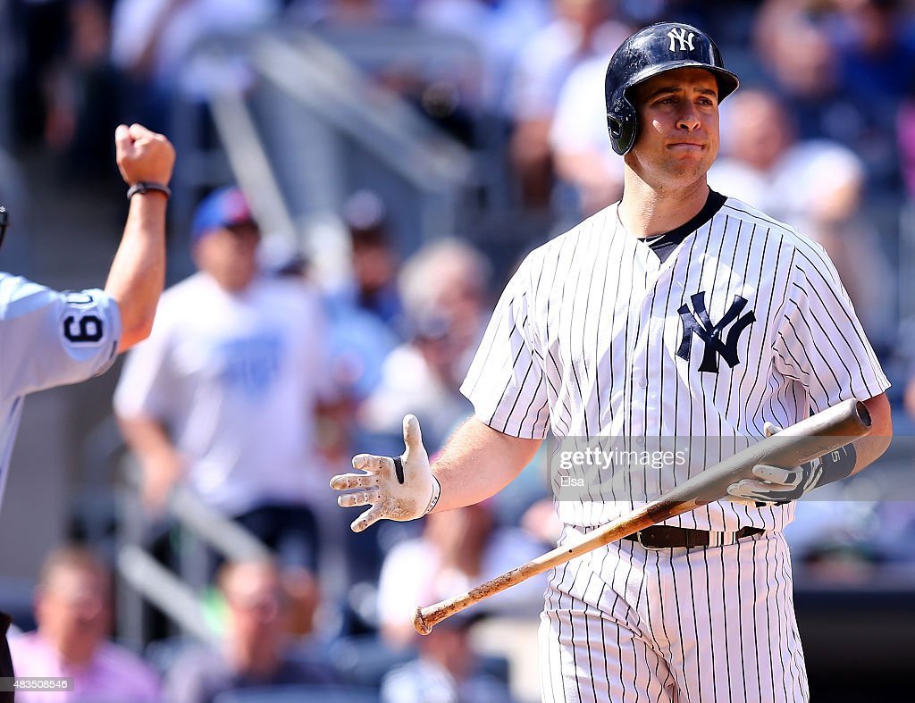Mark Teixeira #25 of the New York Yankees walks back to the dugout after he struck out in the eighth inning against the Toronto Blue Jays on August 9, 2015 at Yankee Stadium in the Bronx borough of New York City.