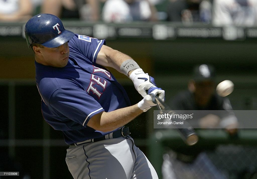 Mark Teixeira of the Texas Rangers hits a tworun broken bat double in the third inning against the Chicago White Sox June 4 2006 at US Cellular Field...