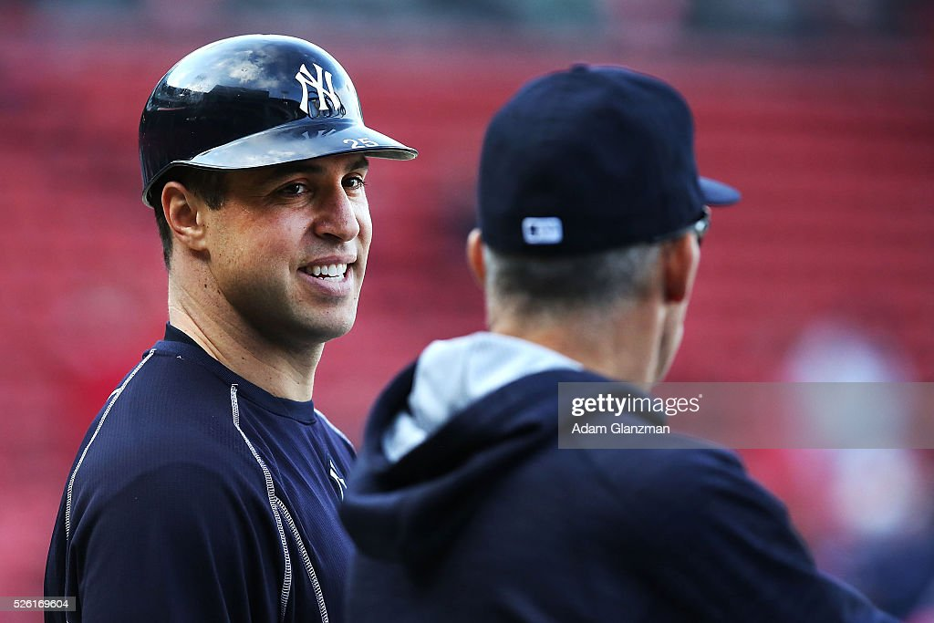 Mark Teixeira #25 talks to Manager Joe Girardi of the New York Yankees during batting practice before the game against the Boston Red Sox at Fenway Park on April 29, 2016 in Boston, Massachusetts.