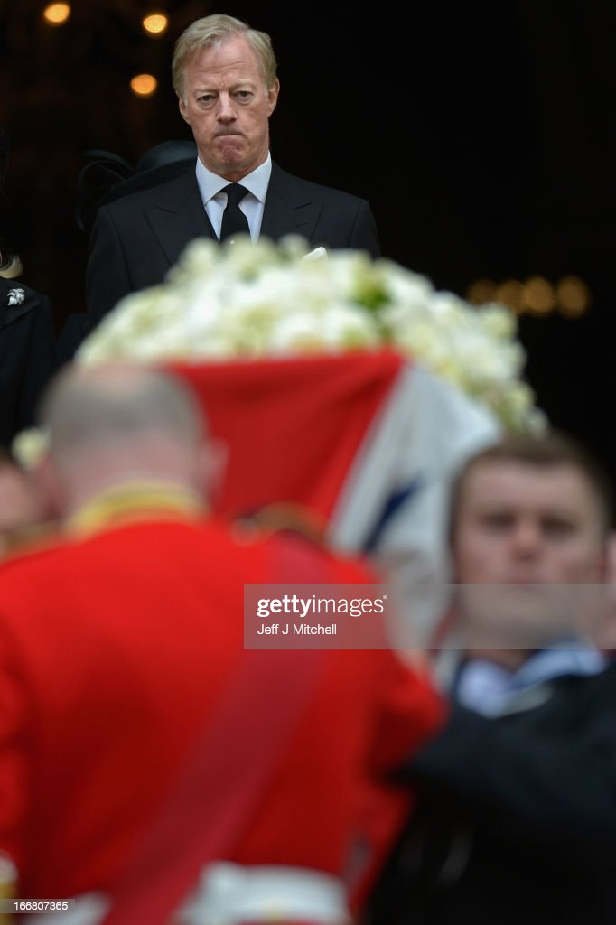 <a gi-track='captionPersonalityLinkClicked' href=/galleries/search?phrase=Mark+Thatcher&family=editorial&specificpeople=220528 ng-click='$event.stopPropagation()'>Mark Thatcher</a> as the coffin is carried down the steps after the Ceremonial funeral of former British Prime Minister Baroness Thatcher at St Paul's Cathedral on April 17, 2013 in London, England. Dignitaries from around the world today join Queen Elizabeth II and Prince Philip, Duke of Edinburgh as the United Kingdom pays tribute to former Prime Minister Baroness Thatcher during a Ceremonial funeral with military honours at St Paul's Cathedral. Lady Thatcher, who died last week, was the first British female Prime Minister and served from 1979 to 1990.