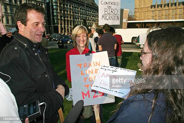 Mark Thomas comedian and reporter in Parliament Square on a Mass Lone Demos campaigning for free speech by demonstrating against the so called...