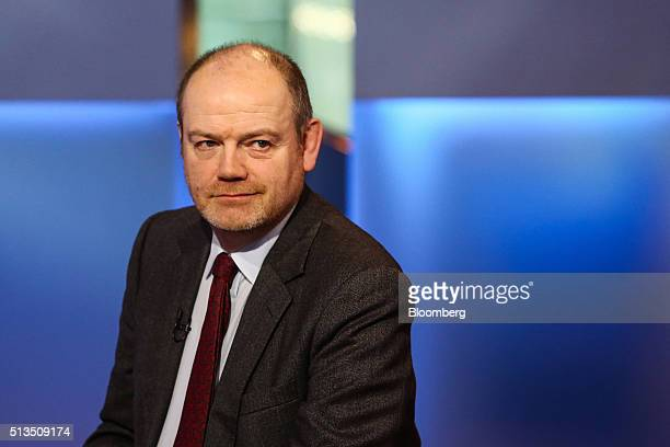 Mark Thompson president and chief executive officer of New York Times Co listens during a Bloomberg Television interview in New York US on Thursday...